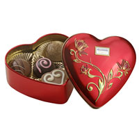 Pralines in heart-shaped tin box